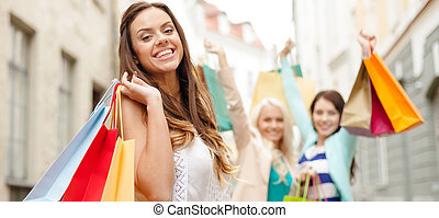 beautiful woman with shopping bags in the ctiy - sale,...