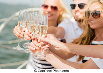 happy friends with glasses of champagne on yacht - vacation,...