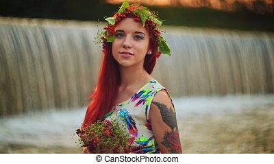 The girl with red hair near the waterfall - Bright girl with...
