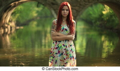 Girl spring - Bright girl with red hair With a bouquet of...