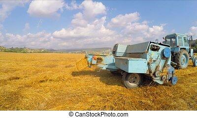 Tractor Baler Making Fresh Bale During Harvesting