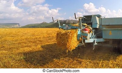 Tractor Baler Discharging Fresh Bale During Harvesting -...