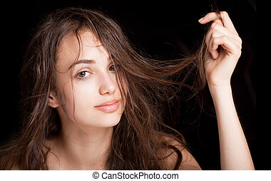 Wet hair beauty. - Portrait of a young brunette beauty with...