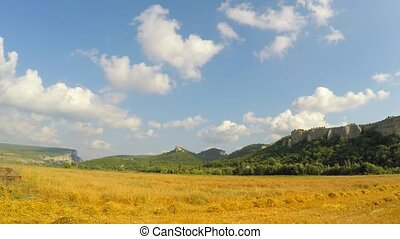 Combine Harvester Mowing Grains At Picturesque Place
