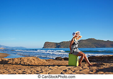 Lost young woman at seaside - Young blond caucasian woman...