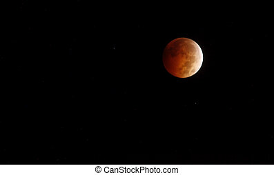 Red Moon Rising - Moon glowing red in the dark night sky...