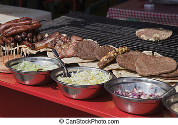 Street food in Serbia - Counter with meat and salads on a...
