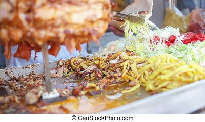 Man preparing kebab - An adult man preparing a kebab for...