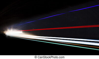 Light tralight trails in tunnel. Long exposure photo in a...