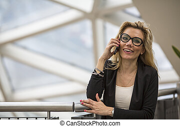 woman speaks on a cell phone