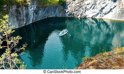 People on Boat Swimming at Marble Canyon Ruskeala in...