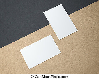 Two business cards on the kraft paper sheet