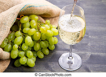 bunch green grapes and wine on wooden background - bunch...