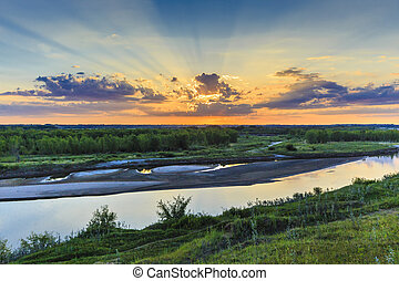 Sunset over the Saskatchewan River - The sun setting over...