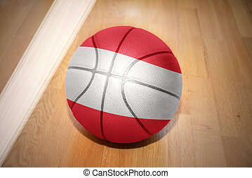 basketball ball with the national flag of austria lying on...
