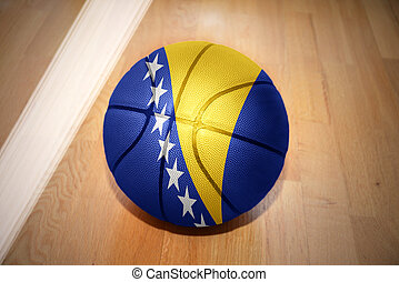 basketball ball with the national flag of bosnia lying on...