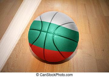 basketball ball with the national flag of bulgaria lying on...