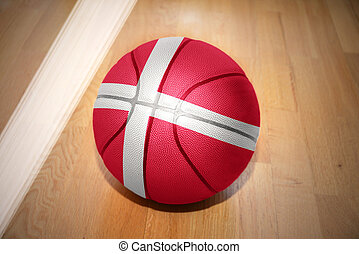 basketball ball with the national flag of denmark lying on...