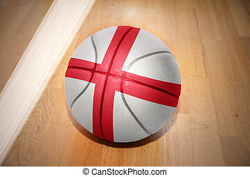basketball ball with the national flag of england lying on...
