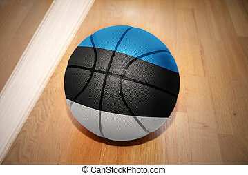 basketball ball with the national flag of estonia lying on...