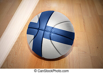 basketball ball with the national flag of finland lying on...