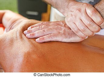 Massage therapist in action