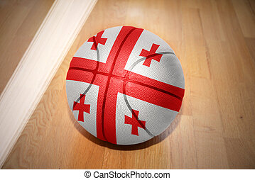 basketball ball with the national flag of georgia lying on...