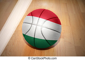 basketball ball with the national flag of hungary lying on...