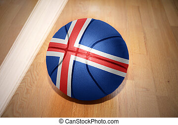 basketball ball with the national flag of iceland lying on...