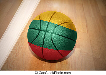 basketball ball with the national flag of lithuania lying on...