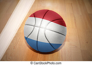 basketball ball with the national flag of luxembourg lying...