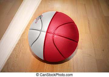 basketball ball with the national flag of malta lying on the...