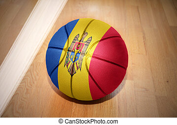 basketball ball with the national flag of moldova lying on...