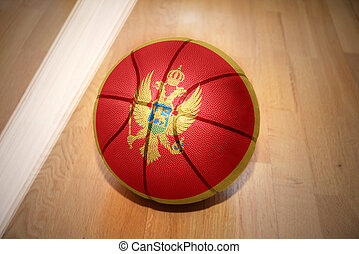 basketball ball with the national flag of montenegro lying...