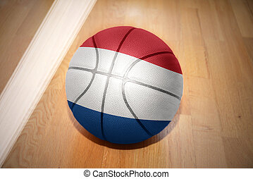 basketball ball with the national flag of netherlands lying...