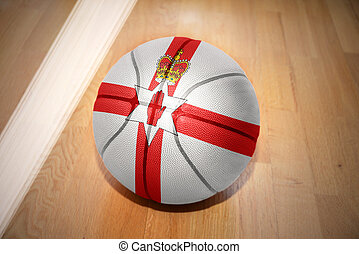 basketball ball with the national flag of northern ireland...