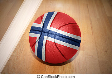 basketball ball with the national flag of norway lying on...
