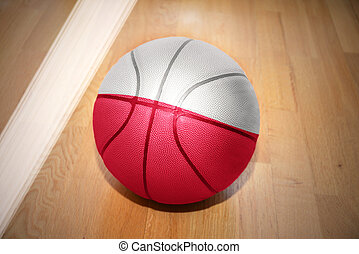 basketball ball with the national flag of poland lying on...