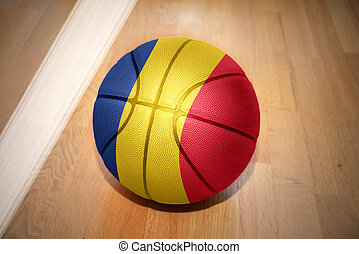 basketball ball with the national flag of romania lying on...