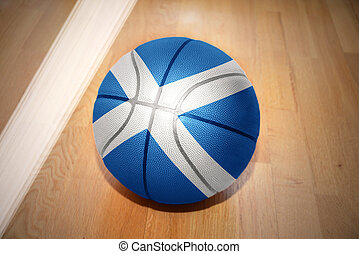 basketball ball with the national flag of scotland lying on...