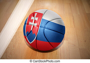 basketball ball with the national flag of slovakia lying on...