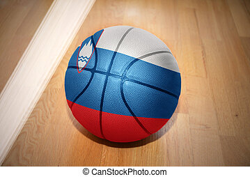 basketball ball with the national flag of slovenia lying on...