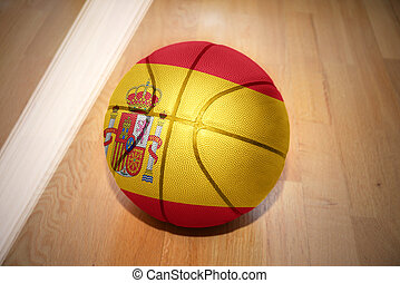 basketball ball with the national flag of spain lying on the...