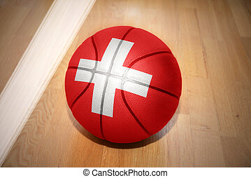 basketball ball with the national flag of switzerland lying...