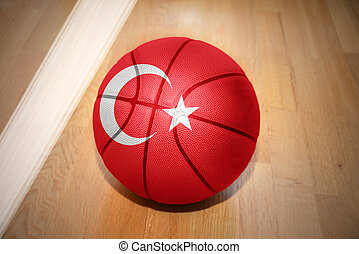 basketball ball with the national flag of turkey lying on...