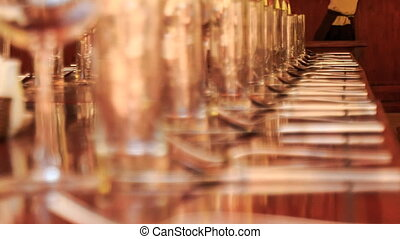 long lines of wine glasses on restaurant table with napkins...