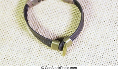 Leather bracelet on burlap - Rotating male leather bracelet...