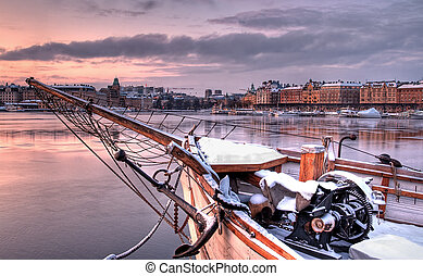 Bowsprit on a ship at sunset.