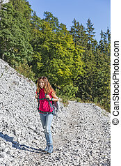 Attractive hiker woman on mountains