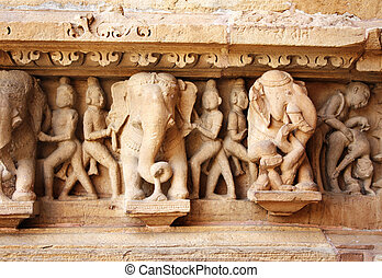 Famous erotic human sculptures at temple, Khajuraho, India -...